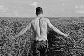 pexels-photo-269198 shirtless man in field